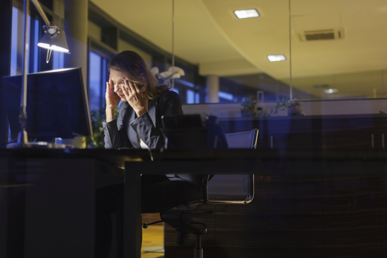 Mature businesswoman working late at her desk.